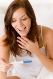 Fototapety Pregnancy test - happy surprised woman