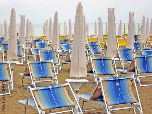 chairs and beach beds closed waiting for tourists