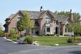 Luxury brick home with cedar shake roof
