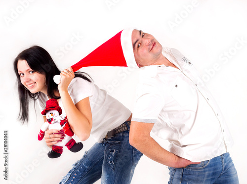 girl pulls Santa cap over. Holidays New Year and Christmas