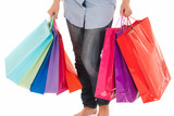 Unrecognizable woman with shopping bags isolated on white poster