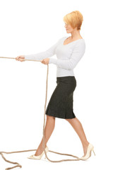 business woman pulling rope