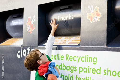 A young boy recycling clothes