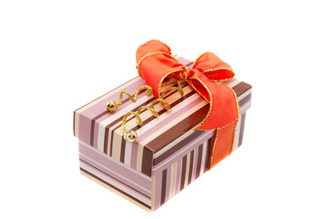 colourful gift box with orange bow isolated on white