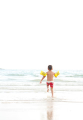 Little boy running to swim