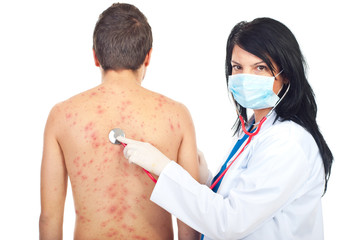 Doctor examine patient with chickenpox