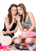 Two pretty girls with candy. Isolated