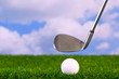 Photo of a golf club hitting ball