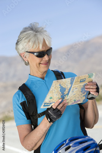 Senior woman reading map