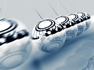 concepto de negocios con balancin de bolas de metal y siluetas