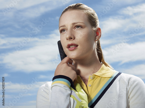Young female golfer, portrait