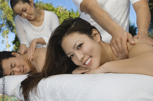 Couple having massage at health spa, close-up