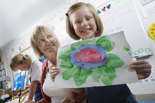 Elementary Student Showing Painting