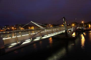 Bridge over River Liffey at night.