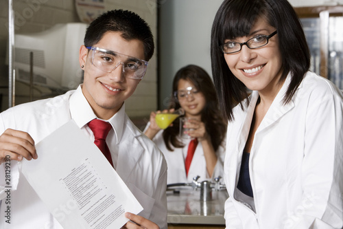 High School Student Holding Curriculum Paper