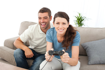 Portrait of a woman playing video game with her boyfriend