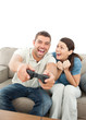 Cheerful woman encouraging her boyfriend playing video game