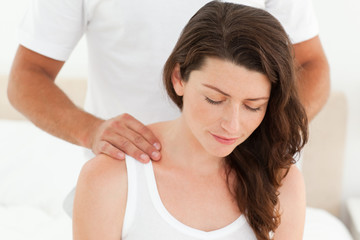 Pretty woman enjoying a back massage from her boyfriend