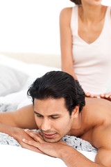 Close up of a woman doing a massage to her boyfriend