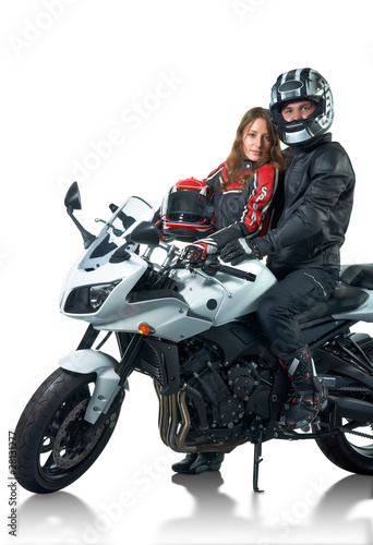 Bikers couple in leather jackets with white motorcycle
