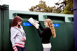 Two teenage girls recycling newspapers
