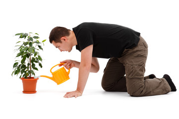 Young man watering flower