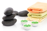 Therapeutic stones with towels and candles in  spa poster