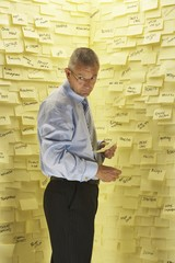 Businessman at Wall with Post Its
