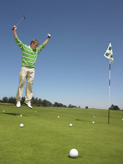 Golfer Cheering on Putting Green