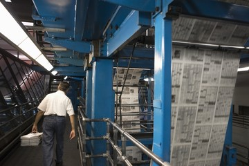 Man working in newspaper factory