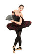 Full length portrait of a beautiful ballerina dancer with fan