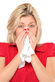 Infected woman blowing her nose in tissue paper because of being poster