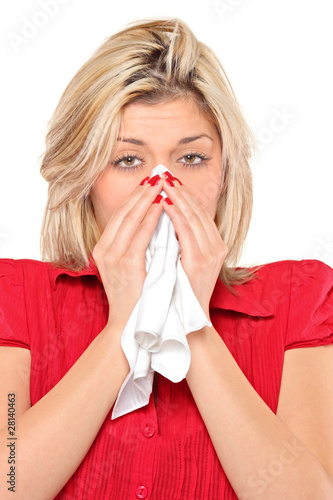 Infected woman blowing her nose in tissue paper because of being