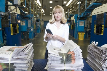 Woman working in newspaper factory, portrait