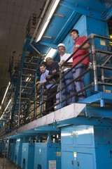 People working in newspaper factory, low angle