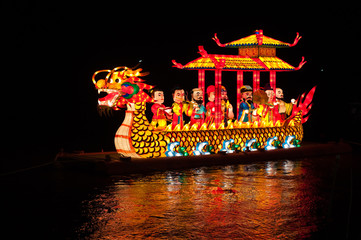 Night shot of dragon boat with lamp in river