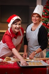 Portrait of mum and daughter at christmas baking