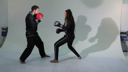 Girl boxing match with a man