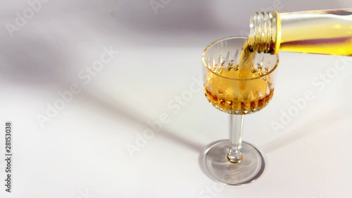 Filling a glass of brandy