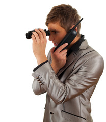 calling young  spy man looking through binoculars