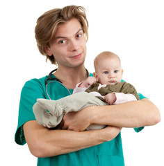 male doctor in green uniform examining baby boy