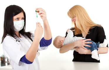 female doctor prepare syringe and examining baby