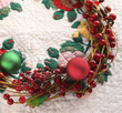 Christmas wreath on quilt