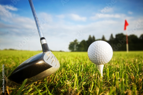 Playing golf. Club and ball on tee