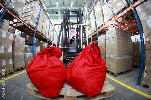 Santa Claus on forklift with two large red sacks - front