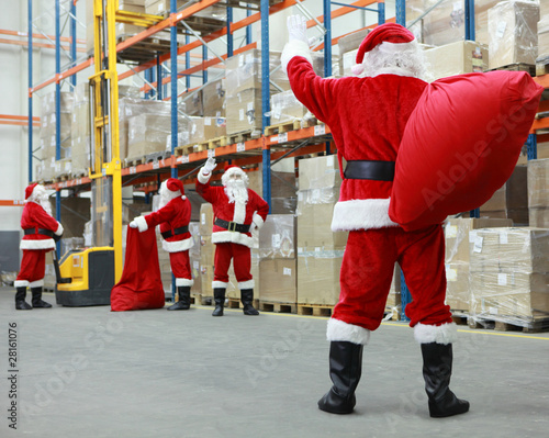 Santa Claus ready for Christmas leaving storehouse