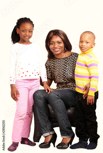 Smiling mommy with children in happy family portrait
