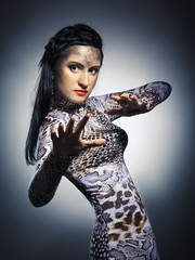 studio shot of woman in shape of snake