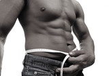Strong man with a helthy body measuring abdomen poster