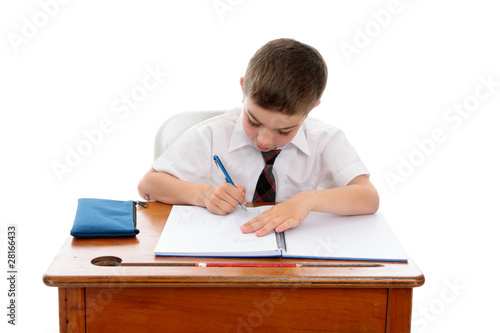 Little boy doing school work or homework